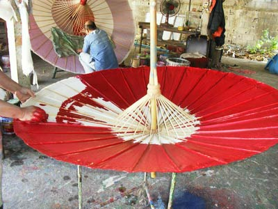 A base coat of waterproof oil based paint is applied in 3 coats to the umbrella.